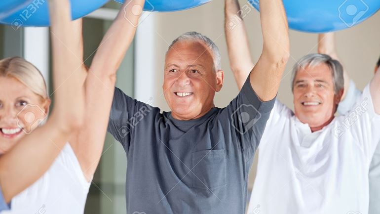 14364380-senior-citizens-exercising-with-blue-gym-balls-in-fitness-center-stock-photo